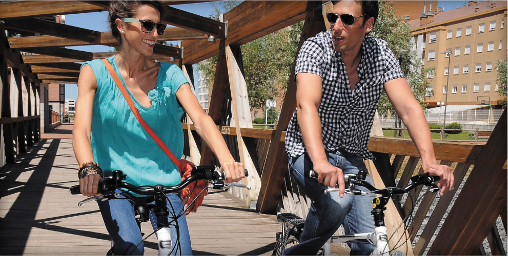 Ebike couple on urban commuter electric bikes
